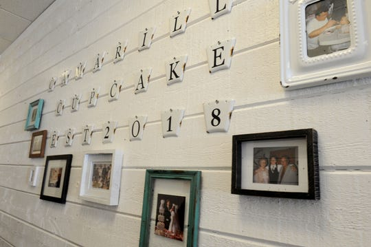 Decor at Camarillo Cupcake includes a family-tree display of photos in the hall that leads to the kitchen.