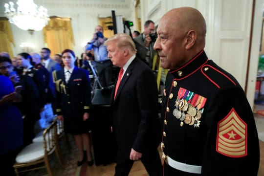 Retired U.S. Marine Corps Sgt. Maj. John Canley, of Oxnard, walks with President Donald Trump for the Medal of Honor presentation ceremony in the East Room at the White House in Washington, Wednesday. Canley is the 300th Marine to receive the nation's highest military medal.