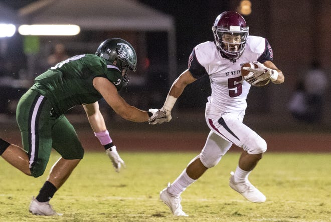 Mt. Whitney's Mike McKernan (5) makes a play in the open field against El Diamante in a West Yosemite League high school football game on Friday, October 12, 2018.