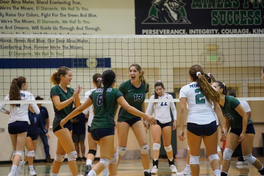El Diamante players celebrate during a West Yosemite League high school volleyball match between Redwood and El Diamante Tuesday night