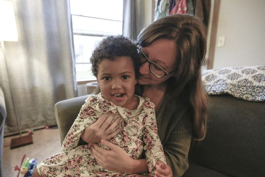 Ashley Lange interacts with her 3-year-old daughter Jane Thursday, Sept. 20, 2018, at her house in Wausau, Wis.