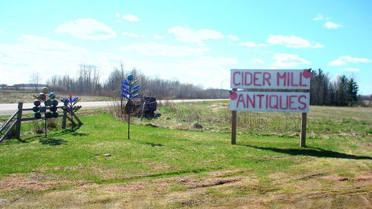 The sign off Wood County P outside Cider Mill Antique Shop near Auburndale.