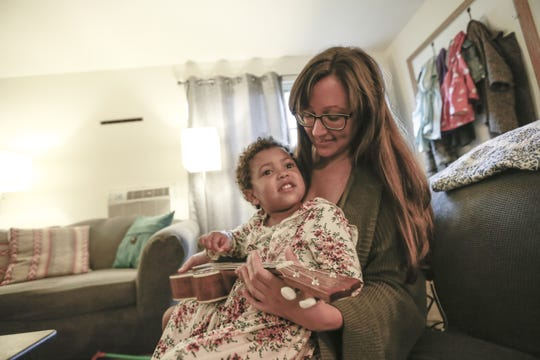 Ashley Lange interracts with her 3-year-old daughter Jane Thursday, Sept. 20, 2018, at her house in Wausau, Wis.