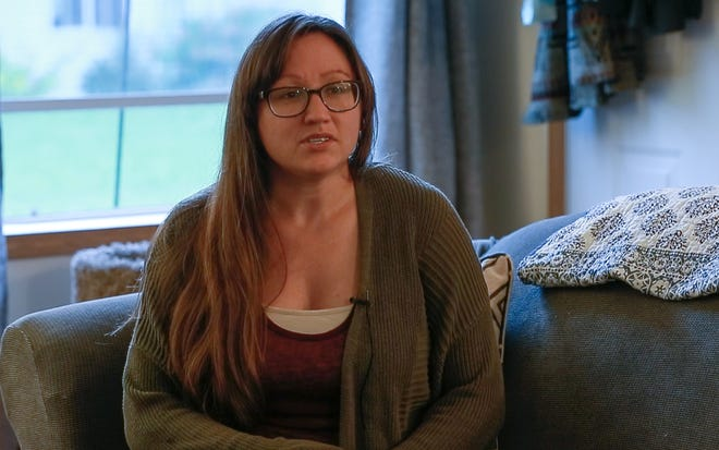 Ashley Lange speaks about her sobriety Thursday, Sept. 20, 2018, at her house in Wausau, Wis. She chose to pursue a local elected office and to speak about her addiction in part because she wanted to be an example to her daughter.