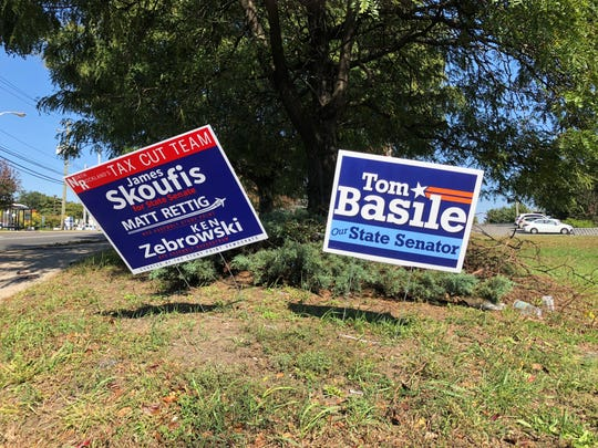Campaign signs from the candidates for state Senate in District 39, along northbound Route 9W by Hi Tor Lanes in West Haverstraw.