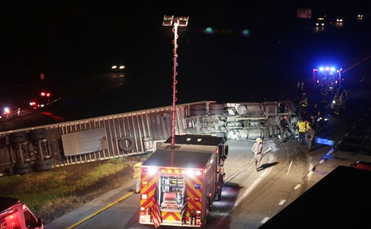 Rescue workers on the scene after a tractor-trailer rolled over coming off of northbound I-684 to eastbound I-84 in the town of Southeast on Oct. 16, 2018. A vehicle traveling eastbound struck the truck after it rolled over, injuring the driver.
