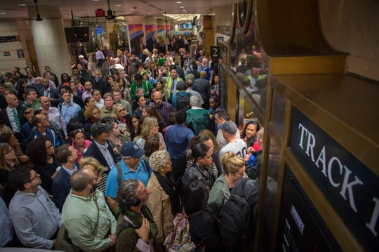 Commuters are seen at the New Jersey Transit platform in Penn Station in New York after a train accident this morning at the Hoboken Train Terminal,  September 29, 2016 in New Jersey. A packed commuter train crashed into a station in New Jersey during the morning rush hour Thursday, with three people reported killed and more than 100 injured, many of them in critical condition. The train failed to stop as it pulled into Hoboken station,, causing major damage to the transit hub just over the Hudson river from Manhattan. / AFP / Bryan R. Smith        (Photo credit should read BRYAN R. SMITH/AFP/Getty Images)