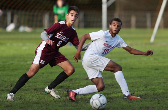 North Rockland's Kenji Harper (10) moves the ball against Scarsdale during boys soccer action at Quaker Ridge School in Scarsdale Oct. 16, 2018. Scarsdale won the game 3-0.