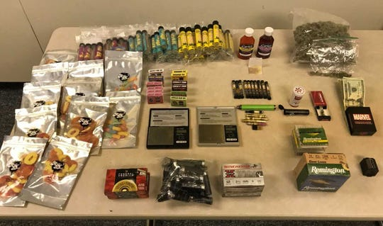 Police executing a search warrant one home seized quantities of marijuana, concentrated cannabis oil, concentrated cannabis edibles, cash and ammunition, police said.