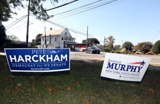 Campaign posters for Democratic candidate Pete Harckham and Republican Sen. Terrence Murphy, who are running in the 40th district Senate race, seen in Peekskill Oct. 17, 2018.