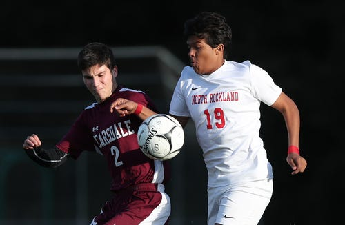 Scarsdale's  Zachary Medvinsky (2) and North Rockland's Fadl Ahmed (19) battle for ball control  defenders during boys soccer action at Quaker Ridge School in Scarsdale Oct. 16, 2018. Scarsdale won the game 3-0.