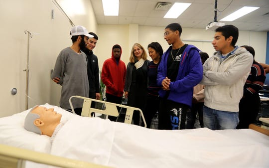 Professor Amy White, center, talks to students about how to interact with hospital patients during a class called Exploring Health Careers at the Ossining Extension Center of Westchester Community College Oct. 17, 2018.