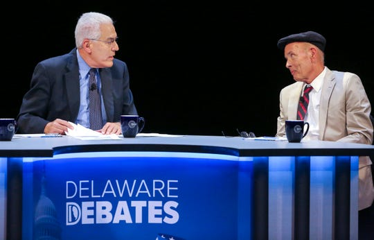 Delaware Congressional candidate Scott Walker (right) responds to a question from moderator Ralph Begleiter in a debate at the University of Delaware's Mitchell Hall Wednesday.