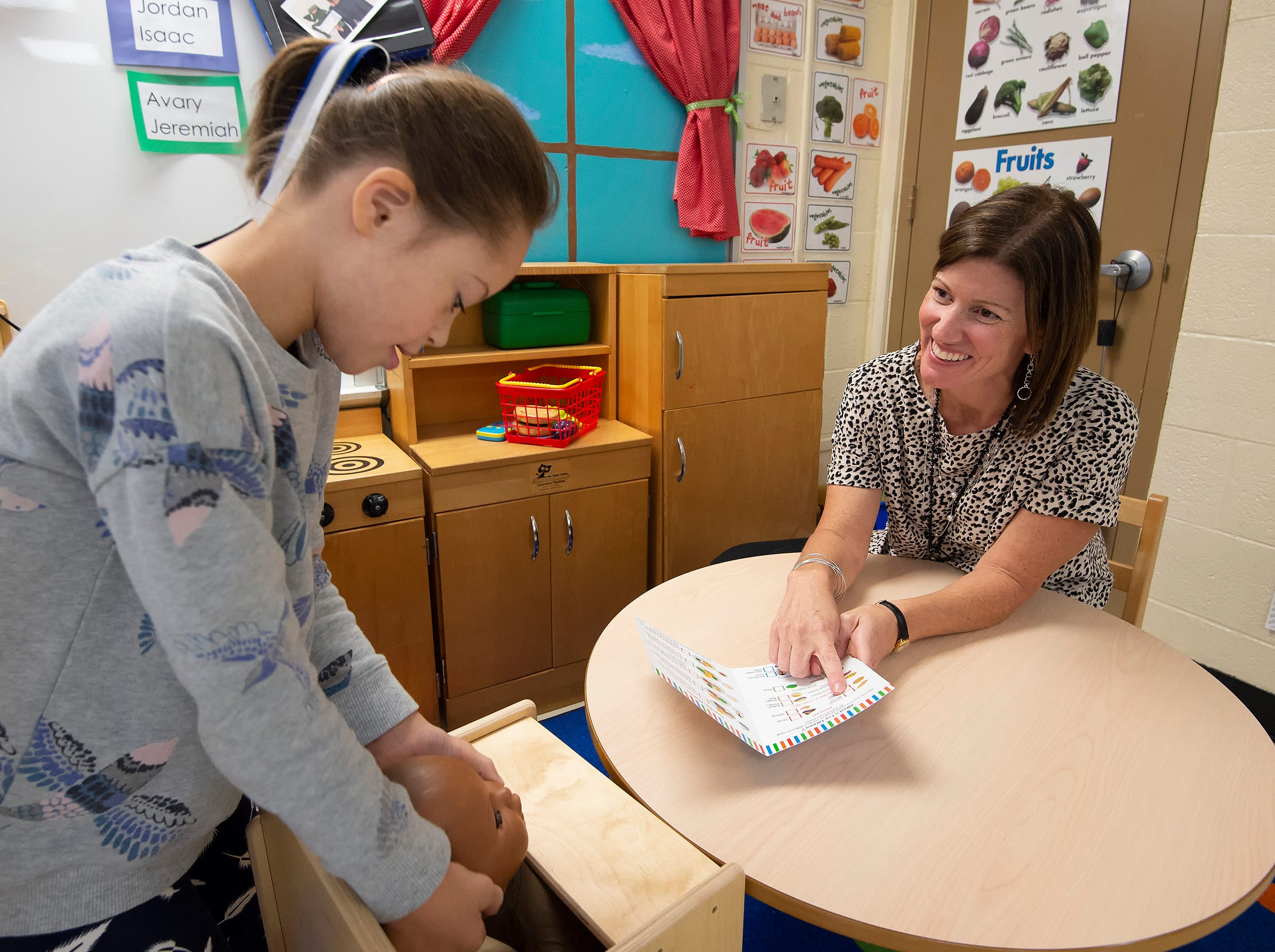 Delaware's 2019 Teacher of the Year Dana Bowe, who teaches kindergarten through second grade for the Sussex County Orthopedic Program at West Seaford Elementary Schol, works with second-grader Avary Cannon.