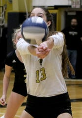 Rider's Meredith Fisher passes in the match against Aledo Tuesday, Oct. 16, 2018, at Rider.