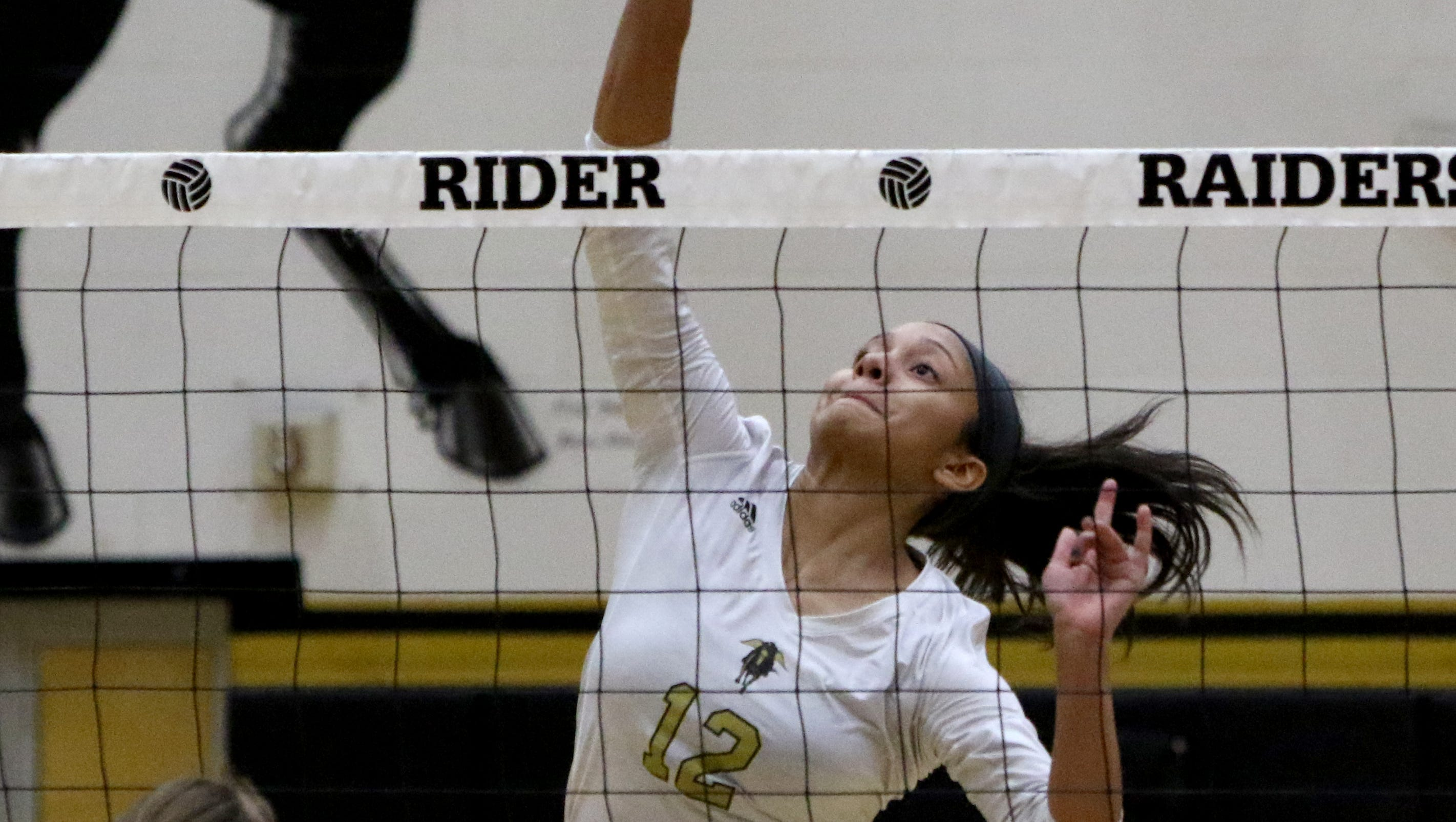 Rider's Alyssa Estrada-Hamby spikes the ball in the match against Aledo Tuesday, Oct. 16, 2018, at Rider.