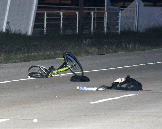 Wichita Falls police work the scene of a motorcycle Vs. a bicycle accident Tuesday night.