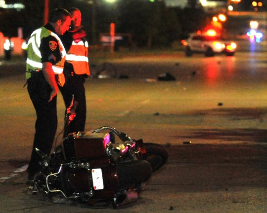 Wichita Falls police work the scene of a motorcycle accident Tuesday night.