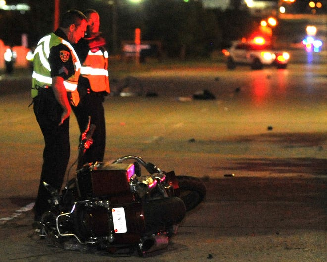 In this 2018 photo, Wichita Falls police work the scene of a motorcycle accident.
