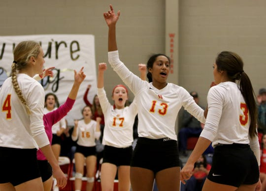 Christ Academy celebrates winning a point against Notre Dame Tuesday, Oct. 16, 2018, at Christ Academy.