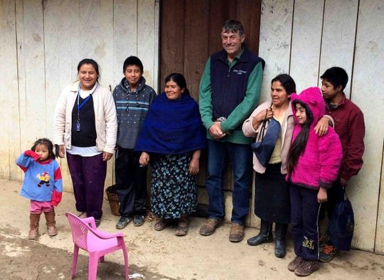 John Rosenow is photographed with the family of his employee, Roberto Tecpile, at their home in rural Mexico in January 2017. Rosenow made the cultural immersion trip with a program sponsored by Puentes/Bridges to meet his employees' families and learn more about their lives.