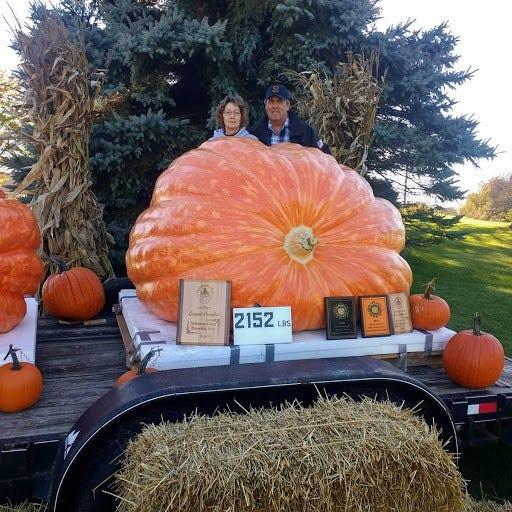 Debbie Gantner and Chuck Hunter pose with Gantner's prize-winning 2,152 lb. pumpking at their rural Oshkosh home.