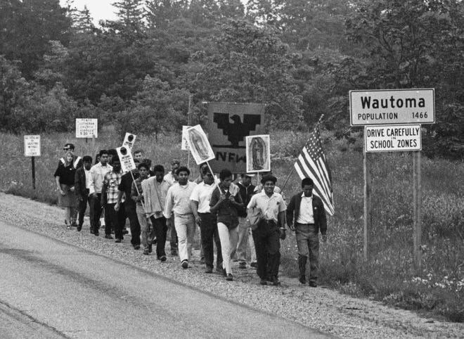 In 1966, members and supporters of Obreros Unidos marched from Wautoma and walking towards Madison along Highway 21 to petition lawmakers for better working conditions for migrant workers from farms and the food industry.