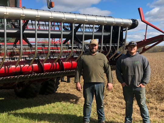 Jeff Lake along with son, Jake (right) have implemented precision agriculture –  including a yield monitor on their combine -  to improve Return on Investment (ROI) on their cropland .