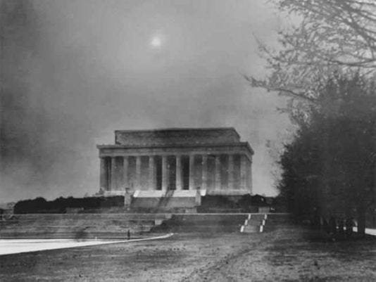 The Lincoln Memorial in Washington D.C. engulfed in a dusty haze nearly blotting out the setting sun on March 21, 1935.