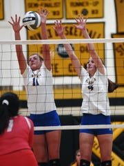 Alexis Samson, left, and Lauren Pickrell, right, play a ball at the net as Maysville topped Lisbon Beaver Local in last year's tournament. Pickrell is one of several returning letter winners for the Panthers.