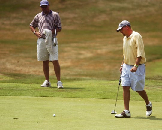 Chad Morrow approaches his ball on the sixth green during the 2010 Zanesville District Golf Association Amateur tournament at EagleSticks. Morrow, now living in Memphis, Tennessee, will be inducted into the ZDGA Hall of Fame tonight.