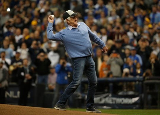 Bob Uecker throws out a ceremonial first pitch before Game 1 of the 2018 NLCS between the Milwaukee Brewers and the Los Angeles Dodgers at Miller Park.