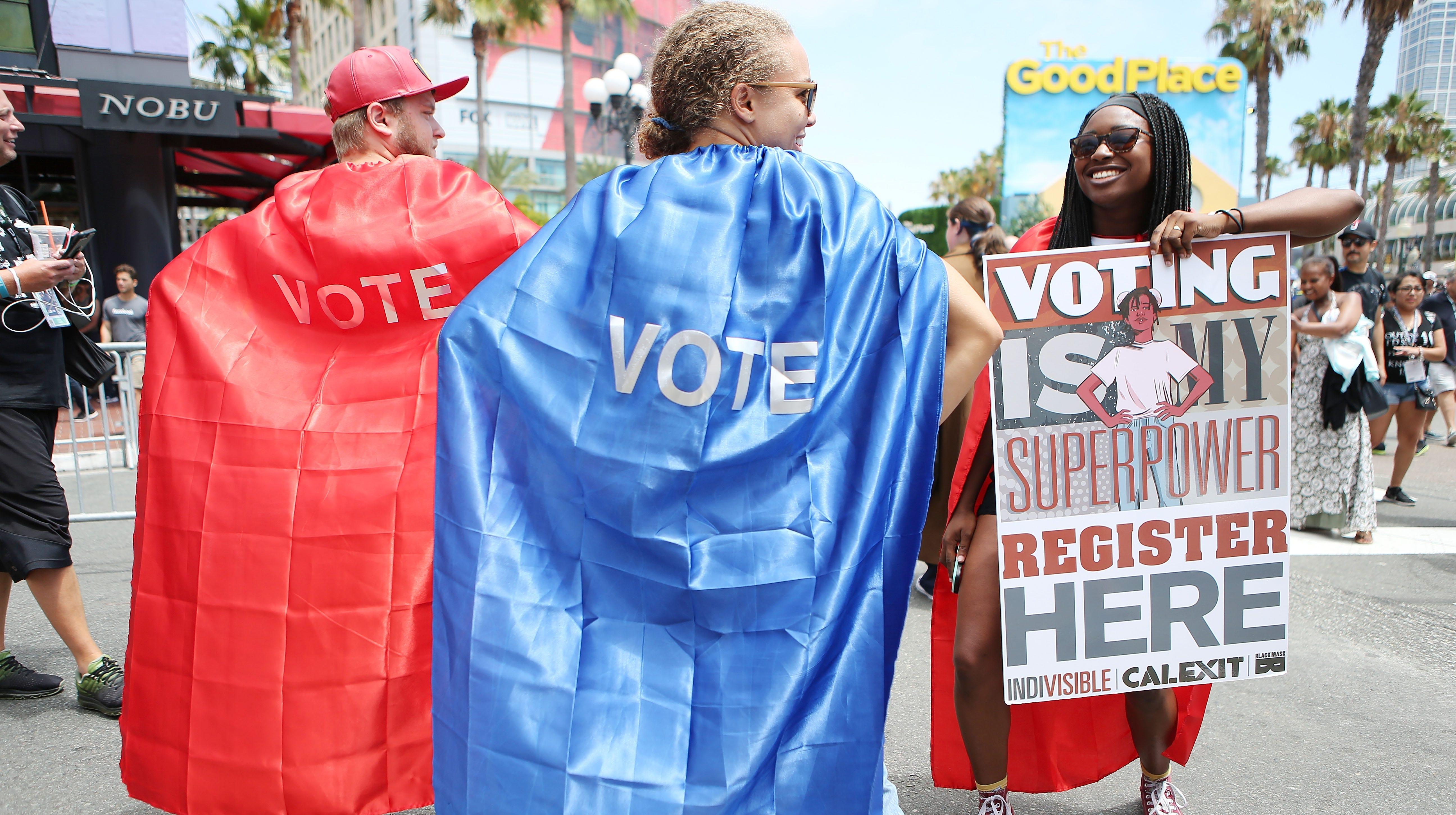 Registering voters in San Diego on July 20, 2018.