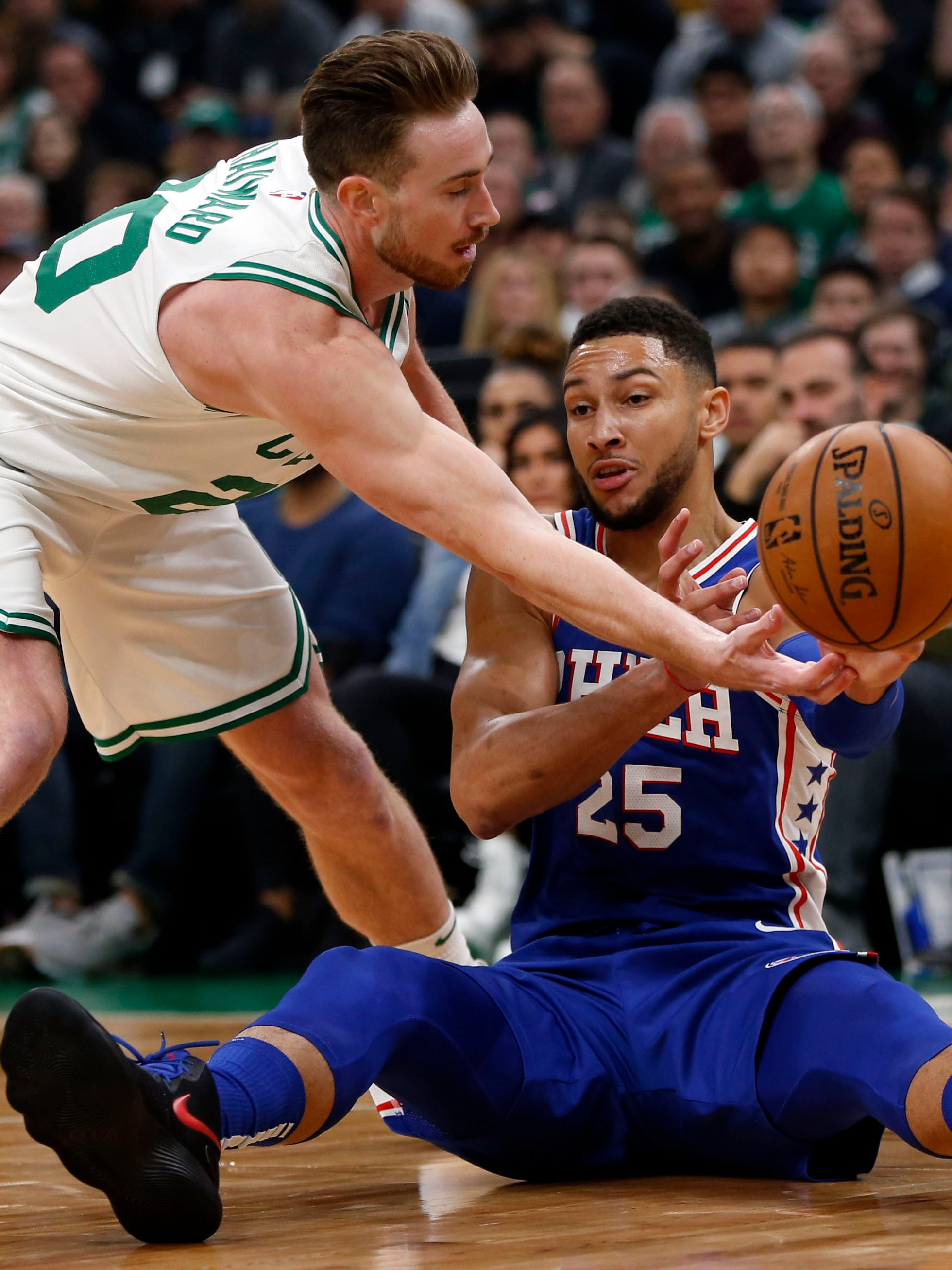 Celtics Gordon Hayward battles with 76ers Ben Simmons for a loose ball during the first half at TD Garden.