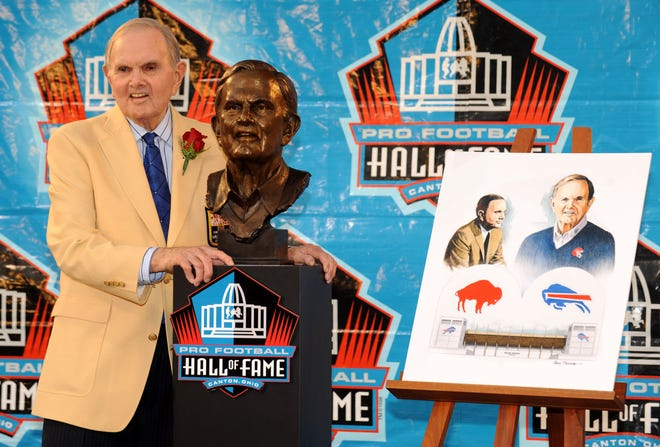 In a file photo from Aug 8, 2009, Buffalo Bills owner Ralph Wilson Jr. poses with bust at the Pro Football Hall of Fame enshrinement at Fawcett Stadium.