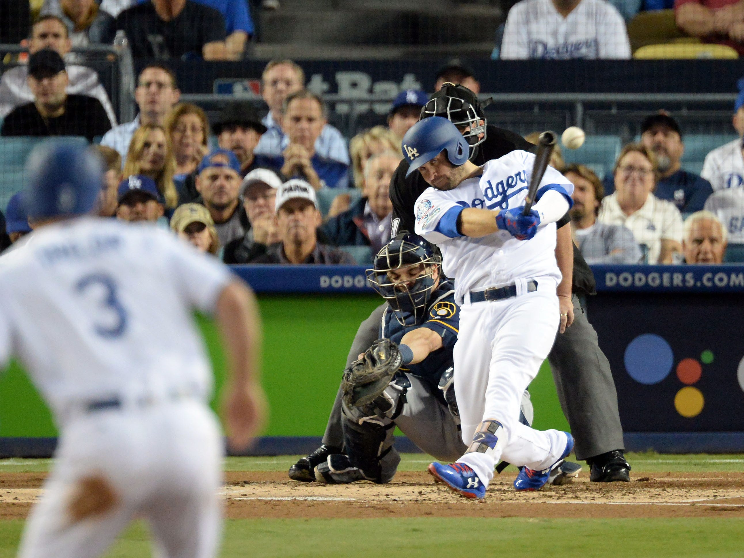 NLCS Game 4: Dodgers second baseman Brian Dozier drives in Chris Taylor in the first inning.