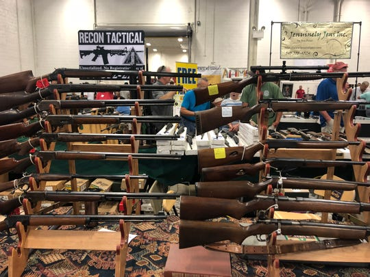 Guns are displayed at a gun show in Chantilly, Va., Sept. 29, 2018.