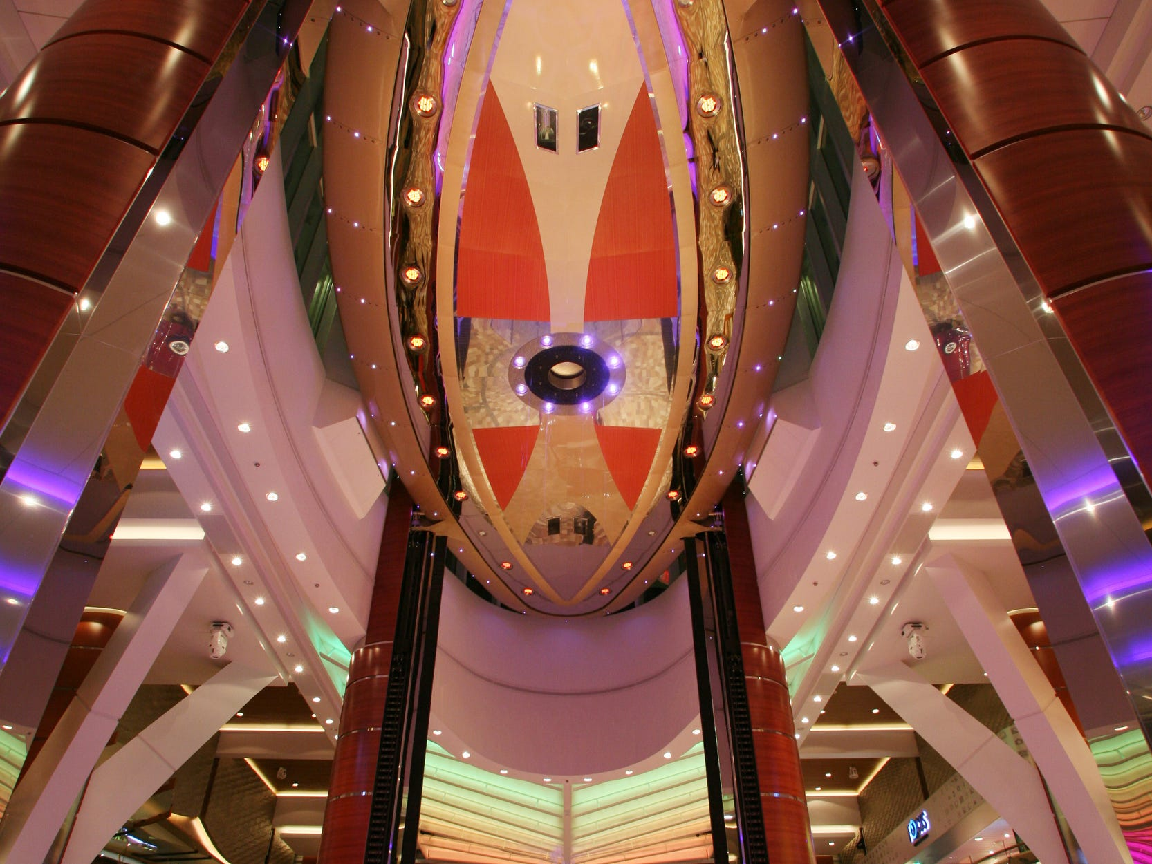 At its highest point, the Rising Tide Bar is above the ceiling of the three-deck-high Royal Promenade found on Royal Caribbean's Allure of the Seas and other Oasis Class ships.