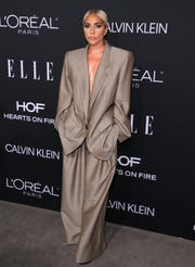 Lady Gaga said she had tried on a number of outfits before plunging into the Marc Jacobs suit of Elle Women's Hollywood Celebration.