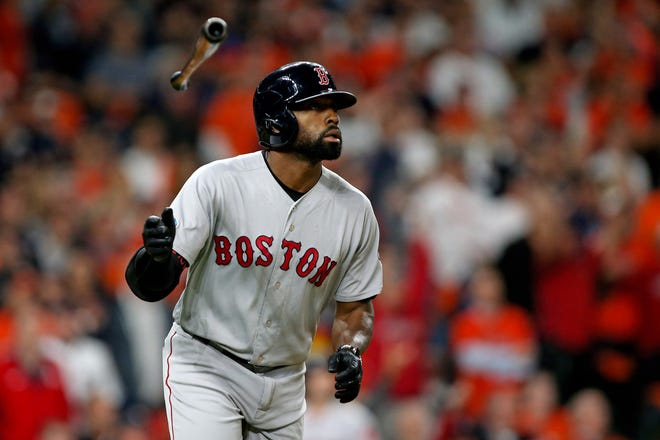 Red Sox center fielder Jackie Bradley Jr. tosses his bat after hitting a grand slam home run in the eighth inning.