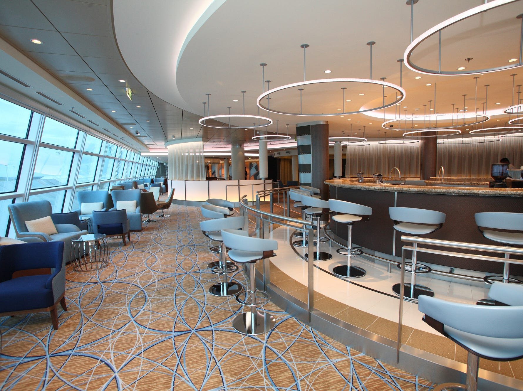 The Sky Bar on Celebrity Reflection overlooks the front of the ship and offers sweeping views from floor-to-ceiling glass windows.