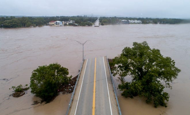 The Llano River flows between the washed out Ranch Road 2900 bridge,  Oct. 16, 2018, in Kingsland, Texas.