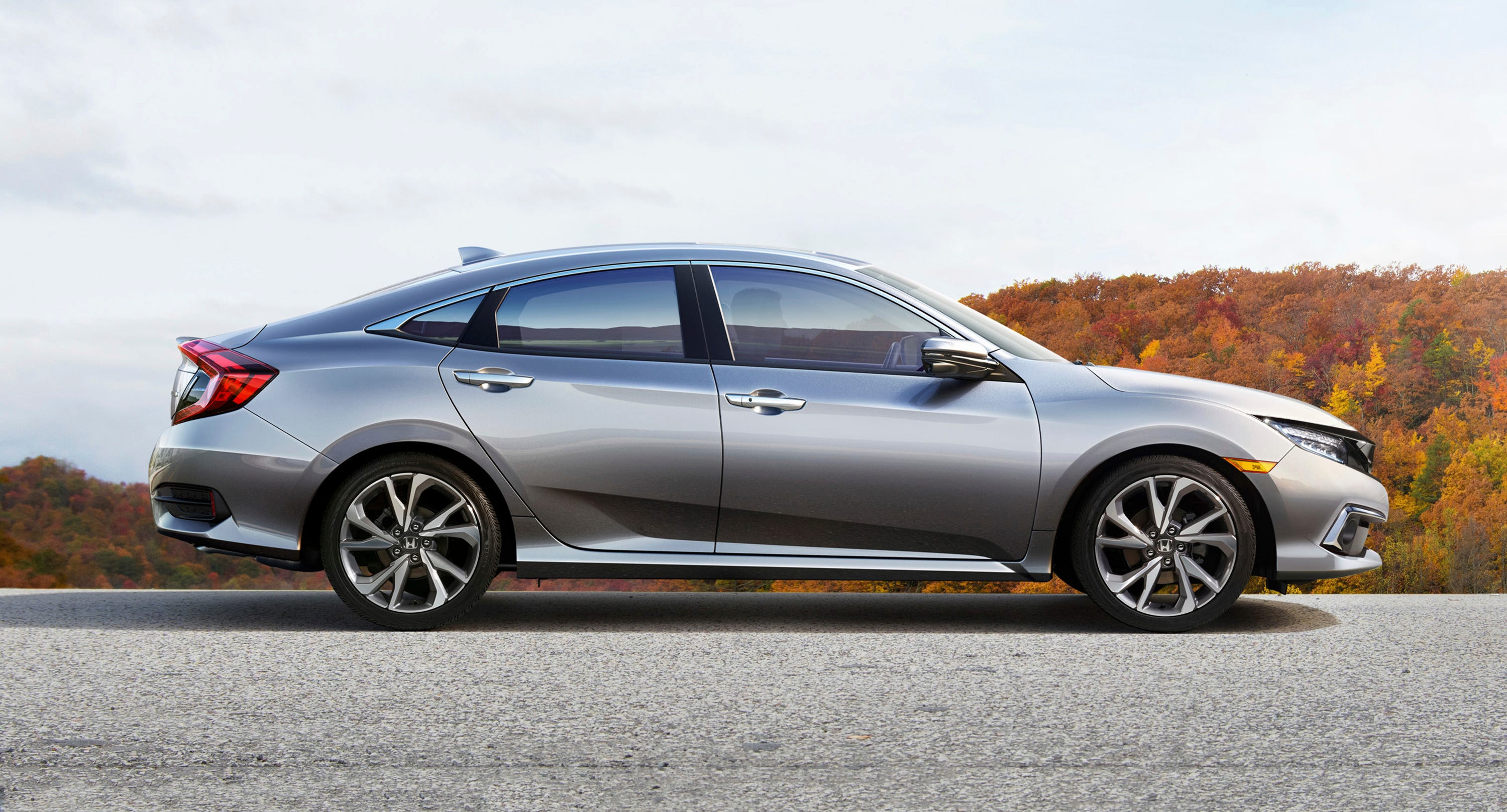 This undated photo provided by Honda shows the 2019 Honda Civic. The Civic is a perennial favorite, and for good reason. Its spacious cabin fits four adults with no problem; even tall passengers can find a comfortable seating position in back. We also like the Civic's entertaining performance and wide range of available body styles. (Courtesy of American Honda Motor Co. via AP)