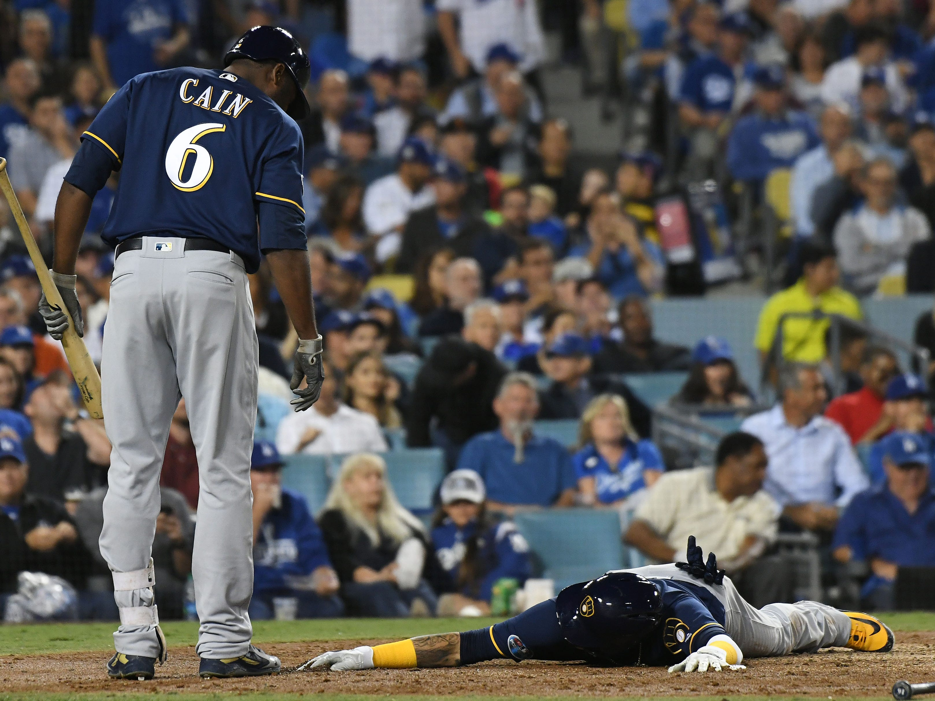 NLCS Game 4: Brewers shortstop Orlando Arcia is exhausted after scoring from first on a double by right fielder Domingo Santana in the fifth inning.