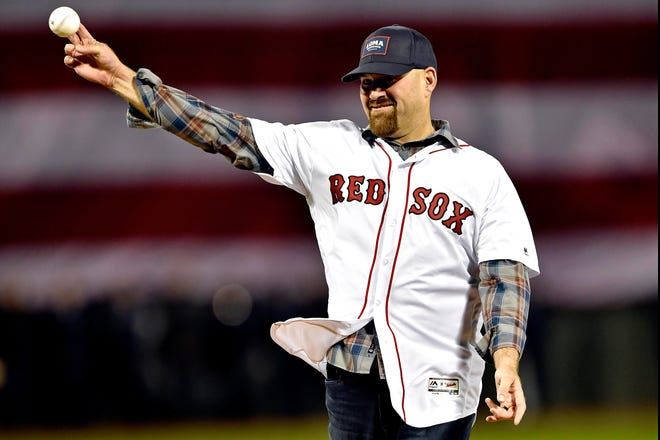 Red Sox former player Kevin Youkilis throws the first pitch before Game 1 of the 2018 ALCS.