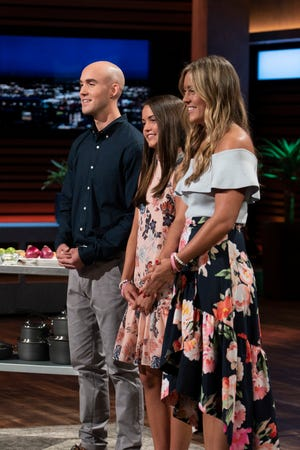 Christian, Keira and Kaley Young, children of a late New York City firefighter, pitch Cup Board Pro, his kitchen product, to the sharks on ABC's 'Shark Tank.'