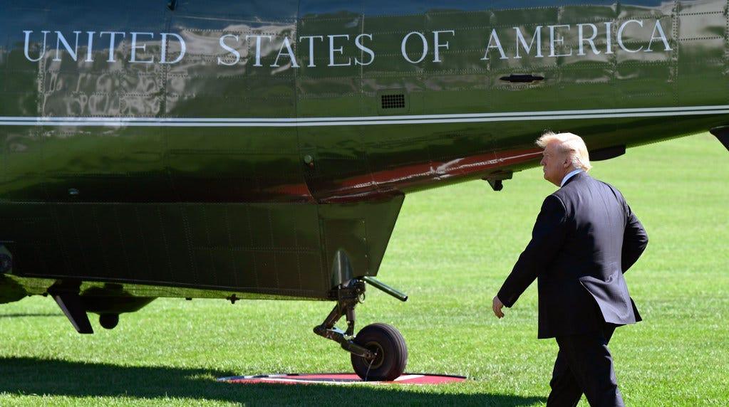 President Donald Trump walks to Marine One on Oct. 12, 2018.