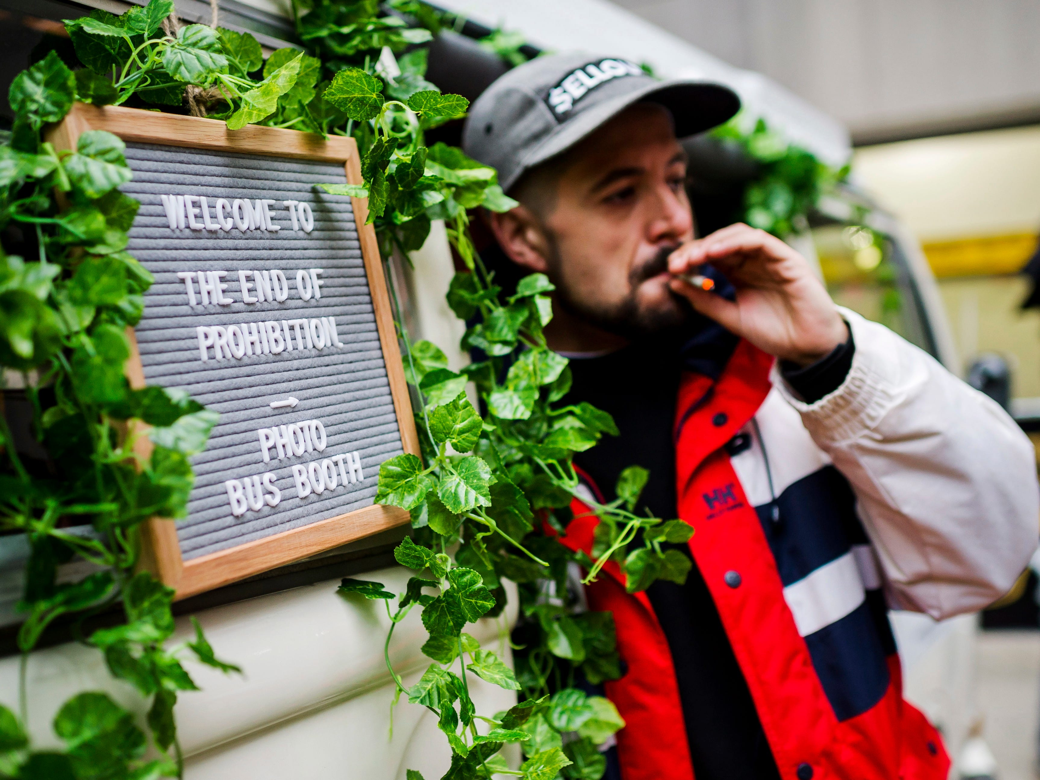 "Matthew Macdougall smokes a joint during a ""Wake and Bake"" legalized marijuana event in Toronto on Wednesday, Oct. 17, 2018. Canada became the largest country with a legal national marijuana marketplace as sales began early Wednesday in Newfoundland. (Christopher Katsarov/The Canadian Press via AP) ORG XMIT: CKL102"