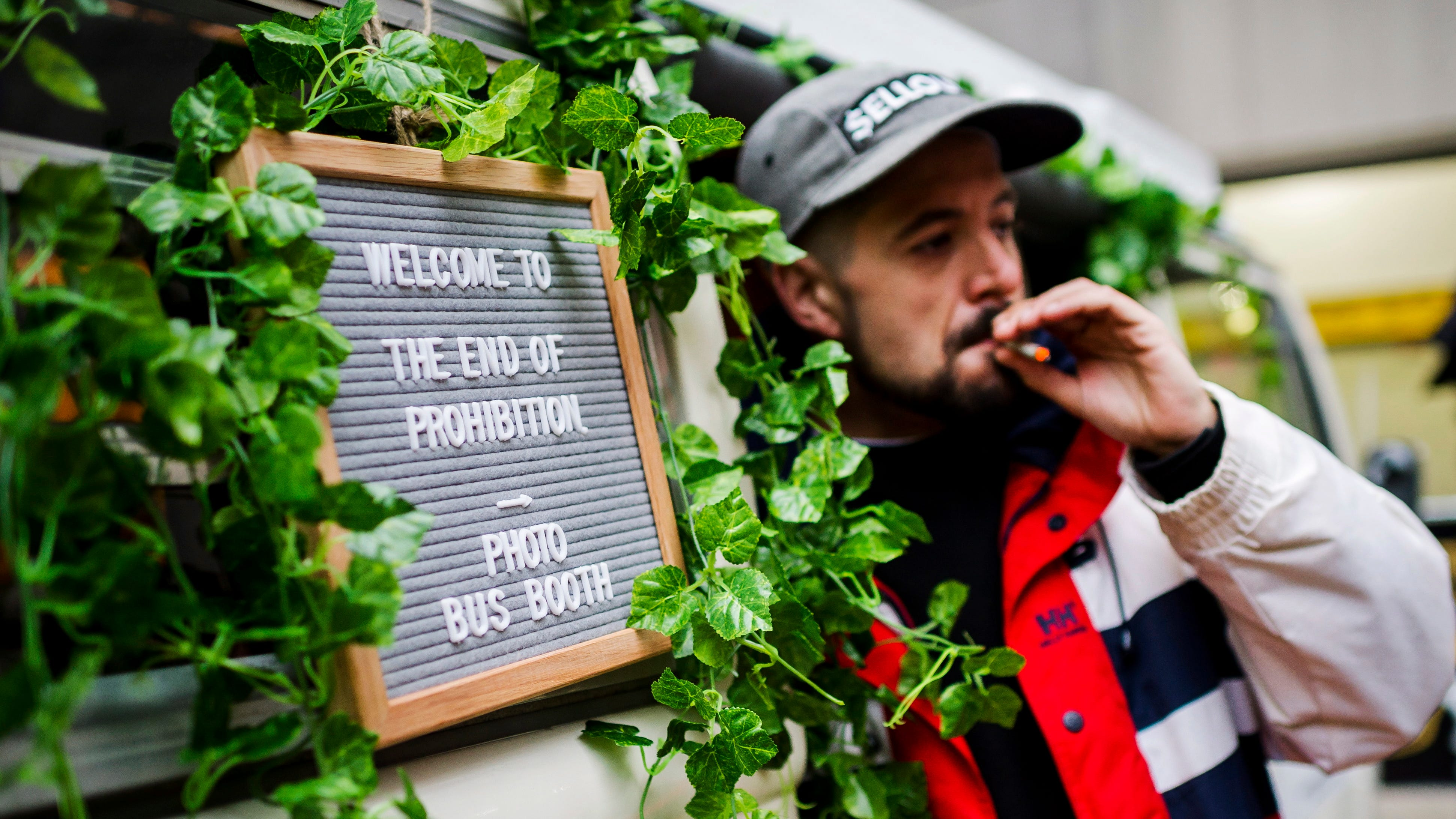 """Matthew Macdougall smokes a joint during a """"Wake and Bake"""" legalized marijuana event in Toronto on Wednesday, Oct. 17, 2018. Canada became the largest country with a legal national marijuana marketplace as sales began early Wednesday in Newfoundland. (Christopher Katsarov/The Canadian Press via AP) ORG XMIT: CKL102"""