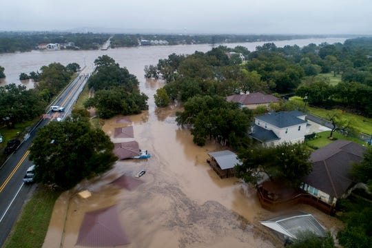 The Llano River overflows its banks into neighboring property in Kingsland, Texas on Oct. 16, 2018.